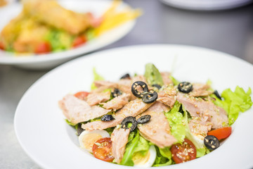 Delicious tuna salad served on white plate