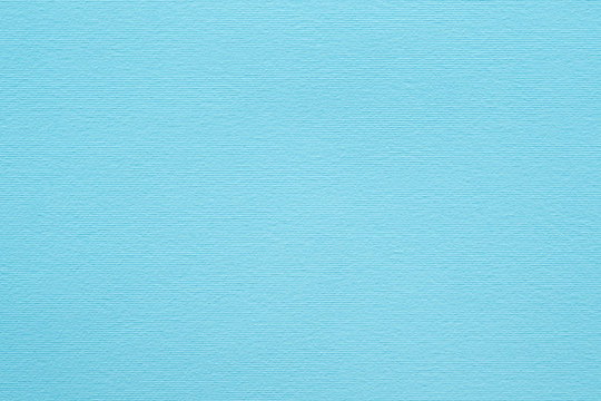 blue paper texture background. colored cardboard fibers and grain. empty space concept.