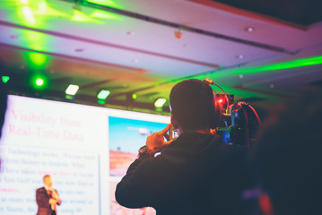 Seminar training workshop event video camera field working recorder commercial production to blurred Spokespersons talk