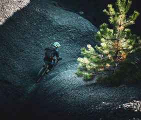 Maritime Alps mountain biker descending steep black rock