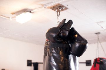 Boxing Glove and Punching Bag in Foreground