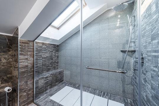 Glass shower cabin in modern loft bathroom