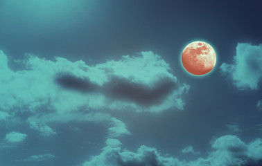 Background of night sky with mysterious clouds and moon eclipse. Moon is taken by me with my camera.