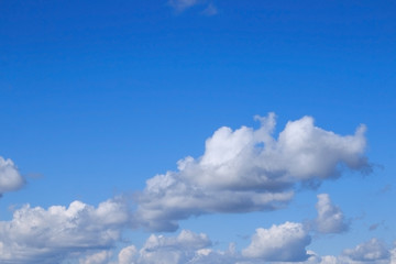 Clouds against blue sky. Blue sky and white clouds.