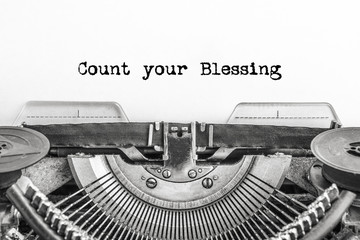 Count your Blessing, the text is typed on a vintage typewriter, in black ink on old paper. close-up