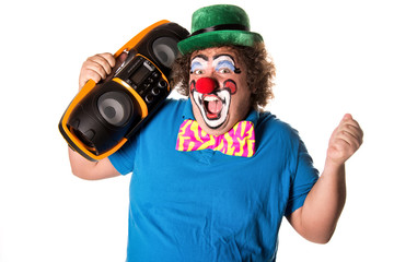 Funny clown listening to music