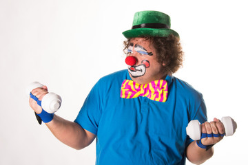 Funny clown and fitness. White background.