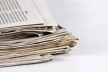 pile of newspapers on table