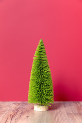 Christmas decoration green fir tree figure on pink backgound