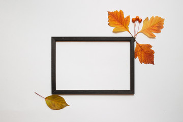 Autumn composition, Flat lay. Wooden photo frame with fresh autumn leaves on white background with copy space Top view. nature, season and decor concept