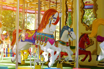 Merry go round, carousel. Vintage horse. Childhood concept.