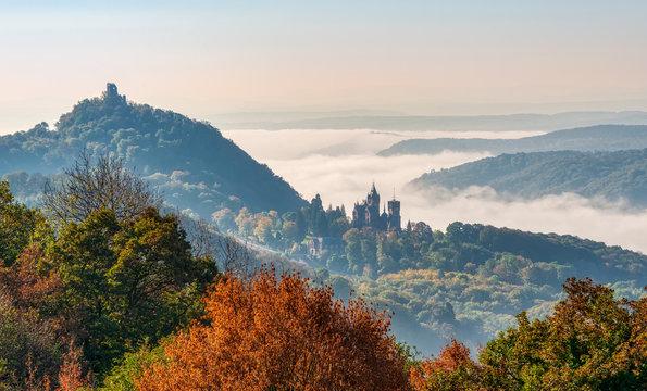 Hill Drachenfels with ruin and castle Drachenburg, Siebengebirge, Germany