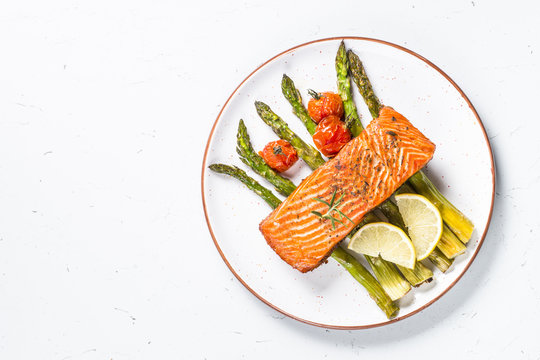 Grilled salmon fish fillet with asparagus.