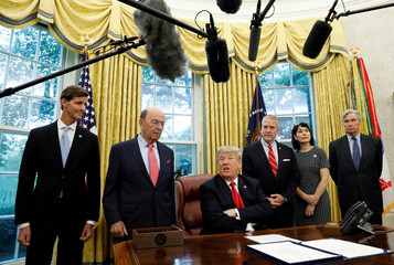 "U.S. President Donald Trump speaks about Hurricane Michael during signing ceremony for the ""Save Our Seas Act of 2018"" at the White House in Washington"