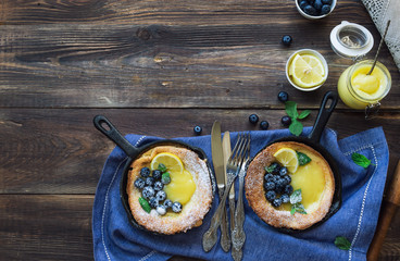 Dutch Baby pancake with lemon curd and blueberries