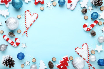 Different christmas decorations with candy canes on blue background