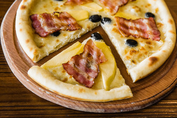 delicious pizza with meat, cheese and mushrooms