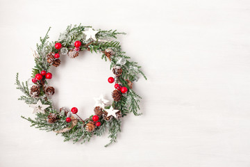 Top view of traditional Christmas wreath with copy space. Winter holidays and Christmas celebration