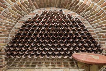 Row of vintage wine bottles in wine cellar