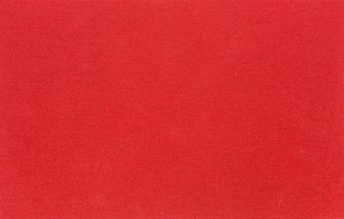 The texture of the canvas fabric is red. Horizontal abstract blank background for design ideas.