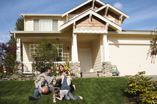 family in front of a house