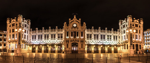 Foto auf Leinwand Bahnhof North Station most important train station in Valencia rail transport, Estacion del Norte Spain wide angle, city lights lighting, night view panorama