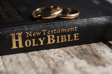 the bible is the base where upon two wedding rings rest