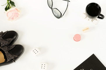 Flat lay, top view  women shoes, sunglasses, cup of coffee on white background. Fashion blog look.trendy beauty female background.copy space