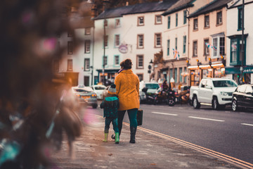 A mother and her son walk down Matlock Bath toward the Matlock Bath Illuminations in October, 2018