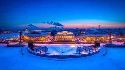 .Russia. Winter Petersburg. The Spit of Vasilyevsky Island from the height of a bird's flight. The St. Petersburg stock exchange building at sunset. Panorama of Saint-Petersburg.