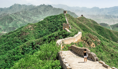 The Great Wall Jinshanling section with green trees in a sunny day, Beijing, China