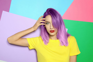 Portrait of young woman with dyed straight hair on colorful background. Trendy hairstyle design