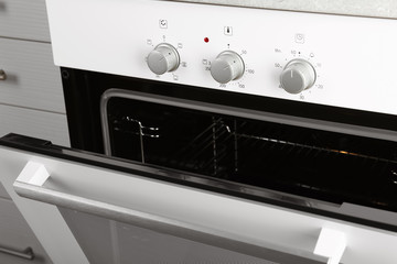 Open empty electric oven in kitchen, closeup