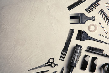 Flat lay composition with hairdresser tools on color background. Space for text