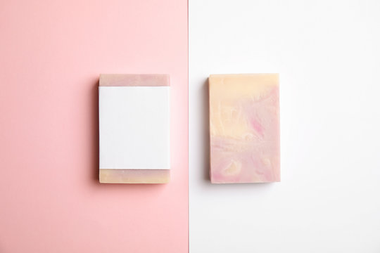 Hand made soap bars on color background, top view. Mockup for design