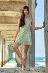 Dancer in a Green Dress Under the Pier