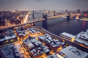 Brooklyn Bridge in snow covered NYC