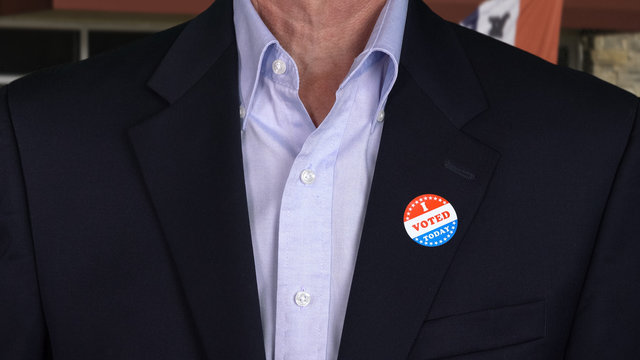 Senior caucasian man in formal clothing with Voted sticker