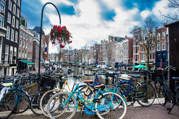 Bikes, canals, flowers and architecture at the Old Central district of Amsterdam