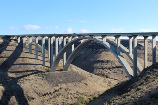 Fred G. Redmon bridge over the Selah creek outside Yakima , Washington. its a beautiful bridge between the canyon with a arch support below in concrete. Blue sky and and clouds in the sky .