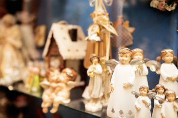 statuettes of angels in a shop window