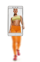 Young female sporty runner training on white background. conceptual image with a smartphone, demonstration of device capabilities