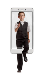 Young boy in school uniform walking on white background, concept virtual reality of the smartphone. going out of the device