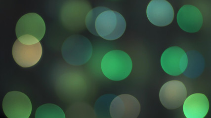 Colorful sparkling bokeh and flashing new year lights in soft focus. Abstract sparkling