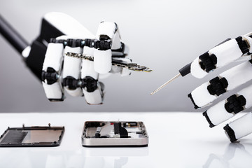 Robot Repairing Smartphone With Screwdriver