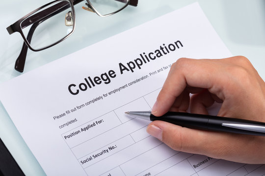 Person Filling College Application Form