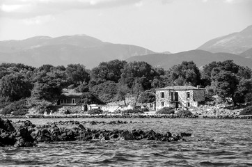 Old abandoned stone houses on a greek small island named Lichadonisia.
