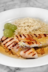 grilled fish with grapes and raisins