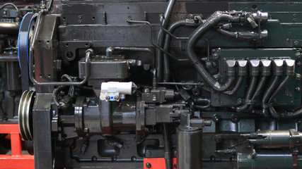 Details and components of machines. Fragment of the diesel engine. Units and assemblies.