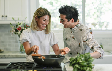 Happy couple cooking in the kitchen